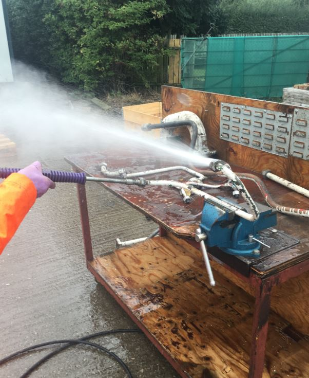 High Pressure Water Jet Cleaning of an Industrial Pipe with a combination of bends