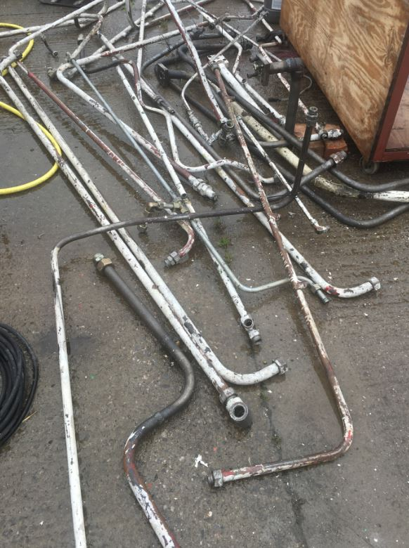 Industrial Hydraulic Pipes of different lengths and diameters all requiring cleaning