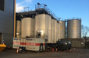 removing 15 years of debris with industrial tank cleaning