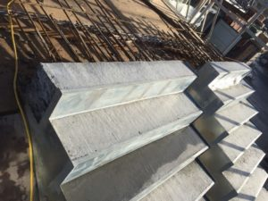 Removing concrete from formwork